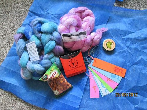 """motheroffive from vagusvenus - """"Very spoilt.   Lovely Teeswater/alpaca mix in pink/lavender shades.    Blue Faced Leicester in Blue ( wonder if it's a natural blue from a blue faced sheep :) )    Lovely cuticle nail cream, tags, Tea, nuts.   All beautifully wrapped in blue paper."""""""