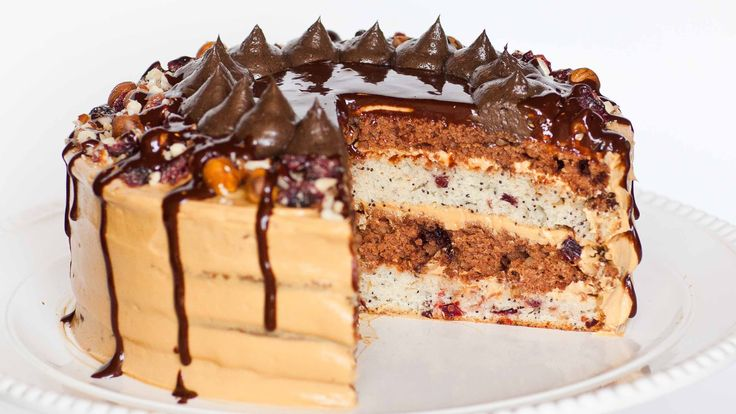 """The Kоролевский Tорт, translating to """"royal cake"""", is a Russian classic! This delicious and moist sour cream cake is made with a variety of fillings, which m..."""