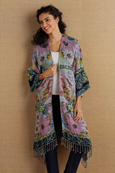 "You're wearing a work of art in this striking woven tapestry cardi. From colorful flowers to black, both embellished with textural hand-embroidered yarn. Artisan-crafted, it's designed with an open front, three-quarter dolman sleeves and self-fringe around the hem. Wool/viscose. 33-1/2""/34-1/2"" long. Philomena Floral Cardi - Item #2AK02"