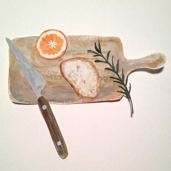 cooking board, bread,orange,rosemary,knife