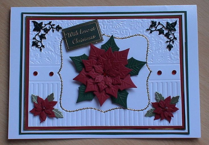 #spellbinders  A simple but stunning card made using my spellbinder poinsettia dies layered on an embossed background ,
