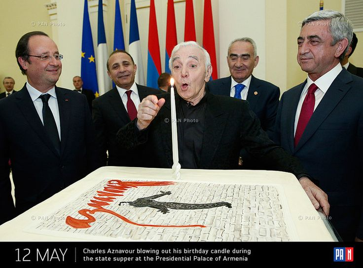 Charles Aznavour blowing out his birthday candle during the state supper at the Presidential Palace of Armenia. Yerevan, Armenia
