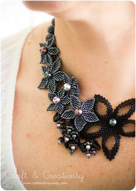 Bead necklace by Margareta Gustavsson (Sweden) posted on the Craft & Creativity blog. Mainly embellished geometric peyote stitch.