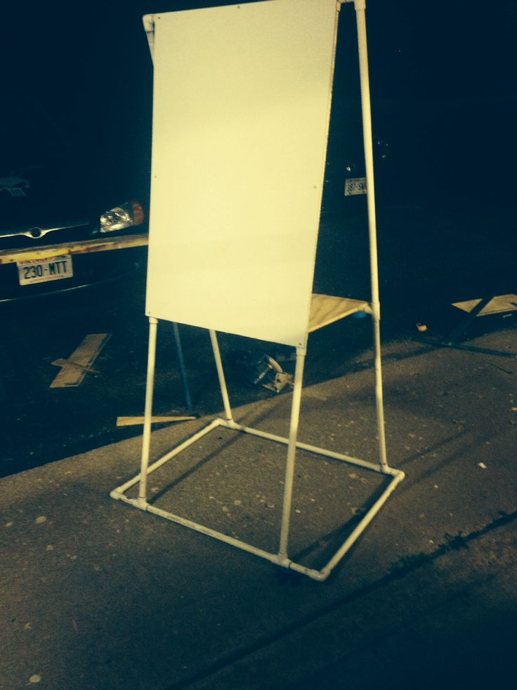 Whiteboard easel made of PVC pipes. Cost about $20. Used 4 10 feet long 1/2 inch PVC pipes, 8 tees, and 6 elbows.