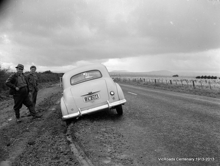 An FX Holden 48 -215 stuck on the soft edges of Hume Highway, Victoria in 1954. VicRoads Centenary 1931-2013.