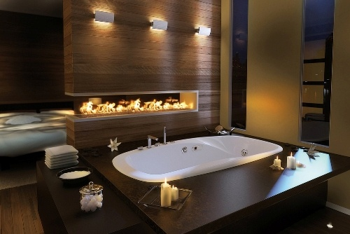 Wood wall, double sided open fireplace, tub, brown and grey. What's not to love?