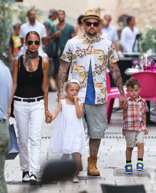 51161388 TV personality Nicole Richie and her rocker husband Joel Madden vacation in Saint-Tropez, France with their children Harlow & Sparrow on July 22, 2013. The happy family grab lunch and take time to ride a carousel. FameFlynet, Inc - Beverly Hills, CA, USA - +1 (818) 307-4813 RESTRICTIONS APPLY: USA ONLY