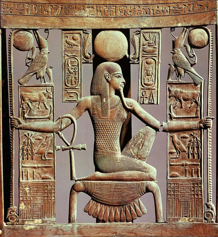 The god of eternity Heh kneeling on the hieroglyphic for Gold