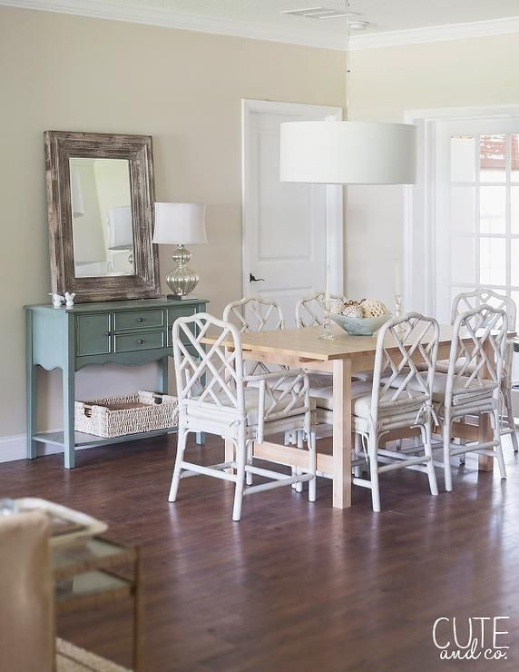 White Chairs And Beige Table With Blue Console