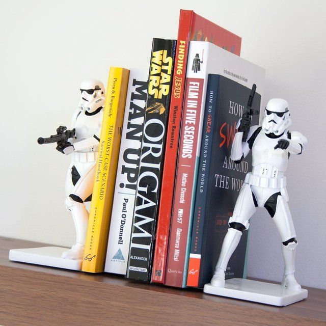 Close the blast doors! These Stormtrooper bookends by Underground Toy are perfect to keep your books upright and orderly. Each one is an action-packed position, ready to guard your books as closely as they guard the Empire. The bookends are made of resin and feature a metal base that slides easily under books. Open the blast doors!...Open the blast doors! 23 x 29 x 16.4 cm