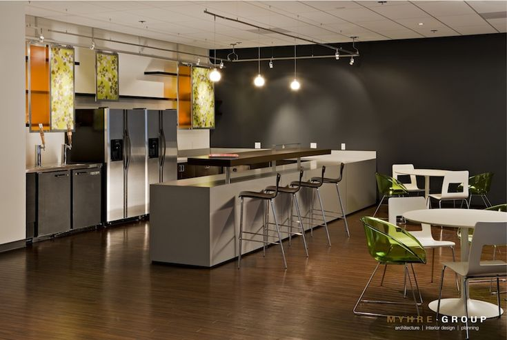 Multi purpose break room with dark gray accent wall for Office lunch room design ideas