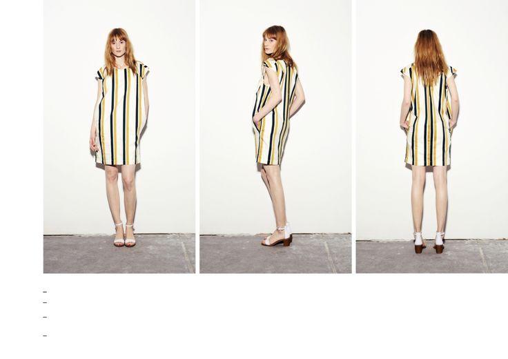 Sleeveless dress with vertical gold-dark green stripes.