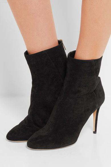 Jimmy Choo's versatile ankle boots are an elegant option for day or evening. Made in Italy, this black suede pair has a comfortable round toe and sleek 85mm heel. Their smart profile and simple design will work with a host of outfits, including for the office. x