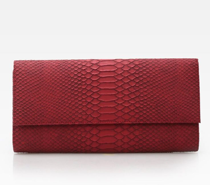 Poiso Ivy Clutch in red by Zorra. A classic clutch with a snakeskin emboss and magnetic closure. This would be perfect for a party and mix and match this with your top. http://www.zocko.com/z/JGjEg