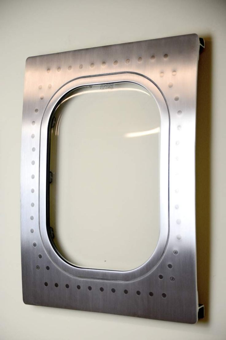 This airplane window was cut from a 767 and turned into a custom aviation decoration wall hanging. It has been sanded and polished to a brushed f...