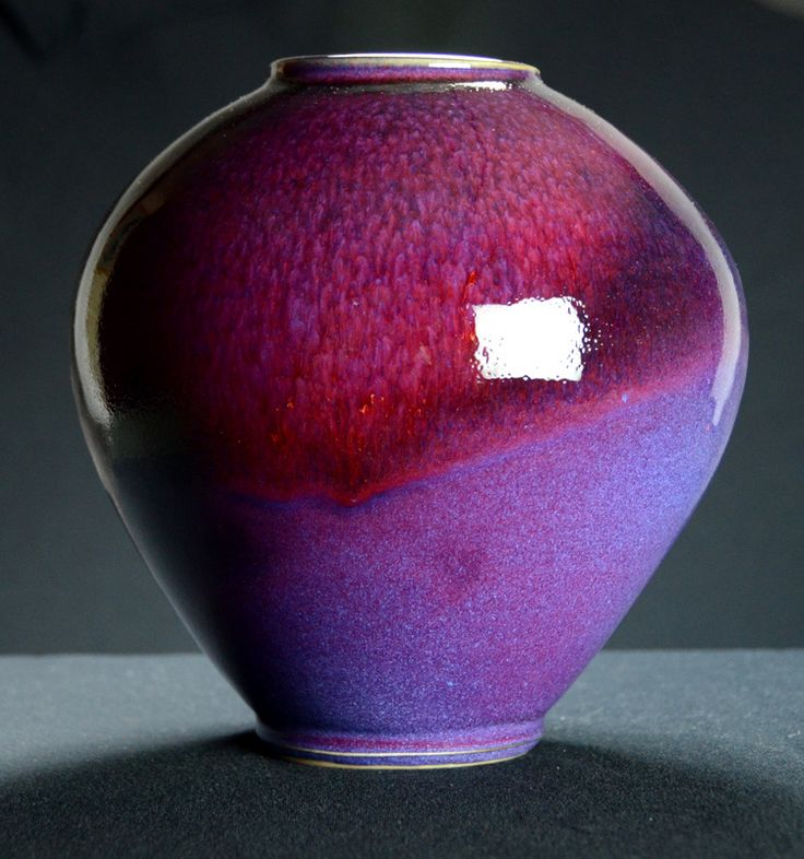Wheel thrown porcelain purple and red vase with an elegant foot. High fired, cone 10. Ceramic vase | Caldwell Pottery