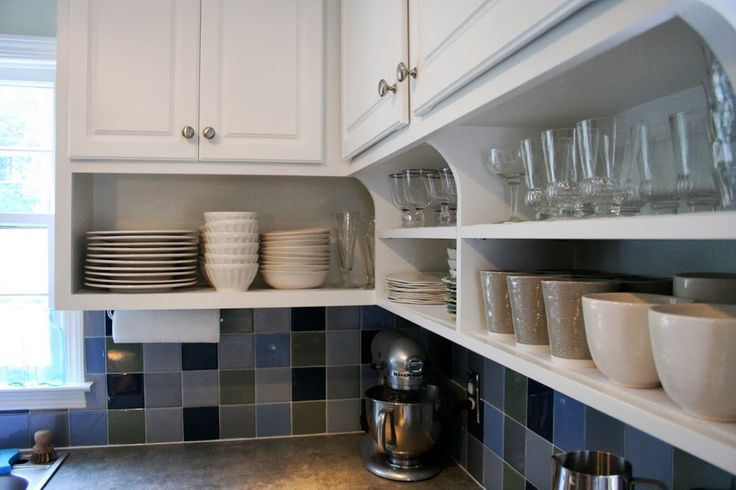 The Benefits Of Open Shelving In The Kitchen: Raise Your Kitchen Cabinets And Add Shelving Underneath