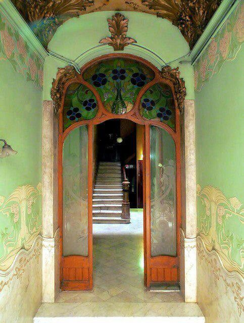 Art Nouveau Entrance hall from late 1800s depicting a green floral  decorative design both on walls