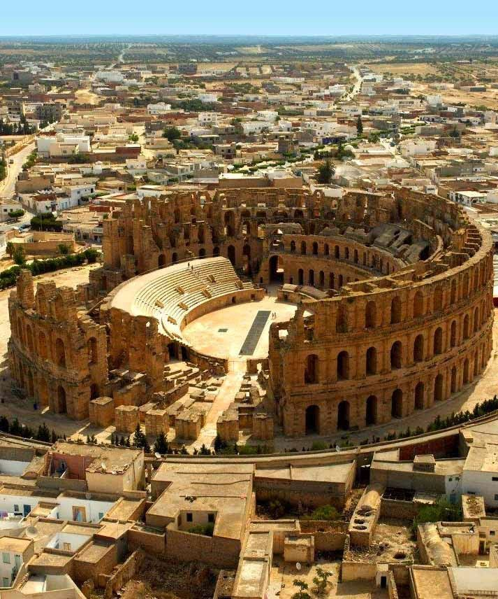 TUNISIA  ~El Djem~   One of the largest arenas of the Roman Empire can be found in the middle of the Tunisian Desert. The amphitheatre of Thysdrus, an enormous structure, emerged out of the barren desert in just 8 years.