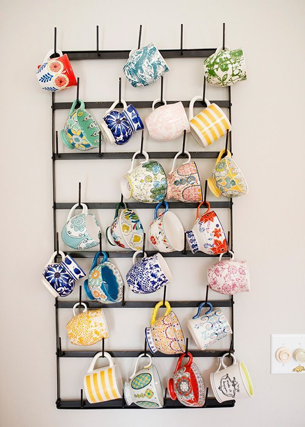 Cute ideas to organize coffee cups at your coffee bar!  ~Deborah. This blogger's coffee cup collection doubles as colorful wall art, punching up a plain wall in her mostly-neutral space. See more at Baked Brie »: #coffeemugs