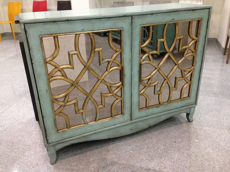 Fantastic turquoise/gold leaf side cabinet perfect for a dining room or bed side tables. www.nestinghabits.ca