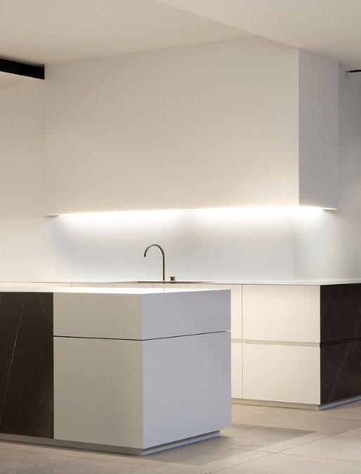 Dark granite + white corian kitchen.