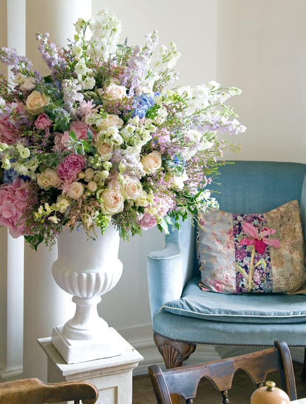 Stunning urn brimming full of pastel blooms, created by Philippa Craddock Flowers http://www.philippacraddock.com/