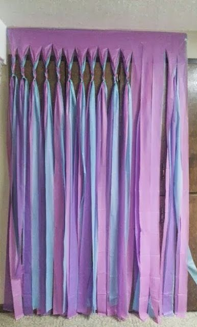 Love the look of hanging streamers but couldn't imagine investing the time to unravel, cut and tape each piece? Try this quick and easy tip: Hang Several layers of plastic table cloth to a door opening. Cut into strips, braid the tops and leave the rest hang.