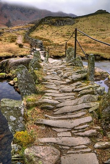 Stone walkway. Path leading off into the distance.