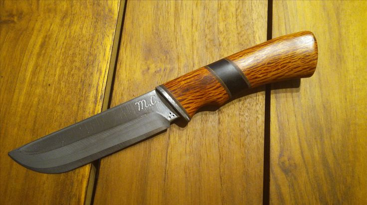Hunting knife. Suminagashi laminated PM steel with SG-2 core. Wooden handle - sheoak and ebony wood.