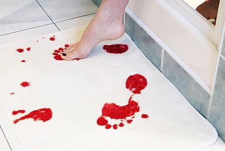 Bath Mat turns red with water. They have matching towels and shower curtains too ... what a fun Halloween decoration! :P