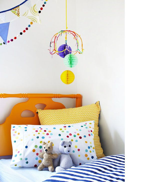 NEW painterly polka dot pillowcase by Poppies for Grace, and tissue balls hanging above.  Photo - Armelle Habib, Styling - Julia Green.