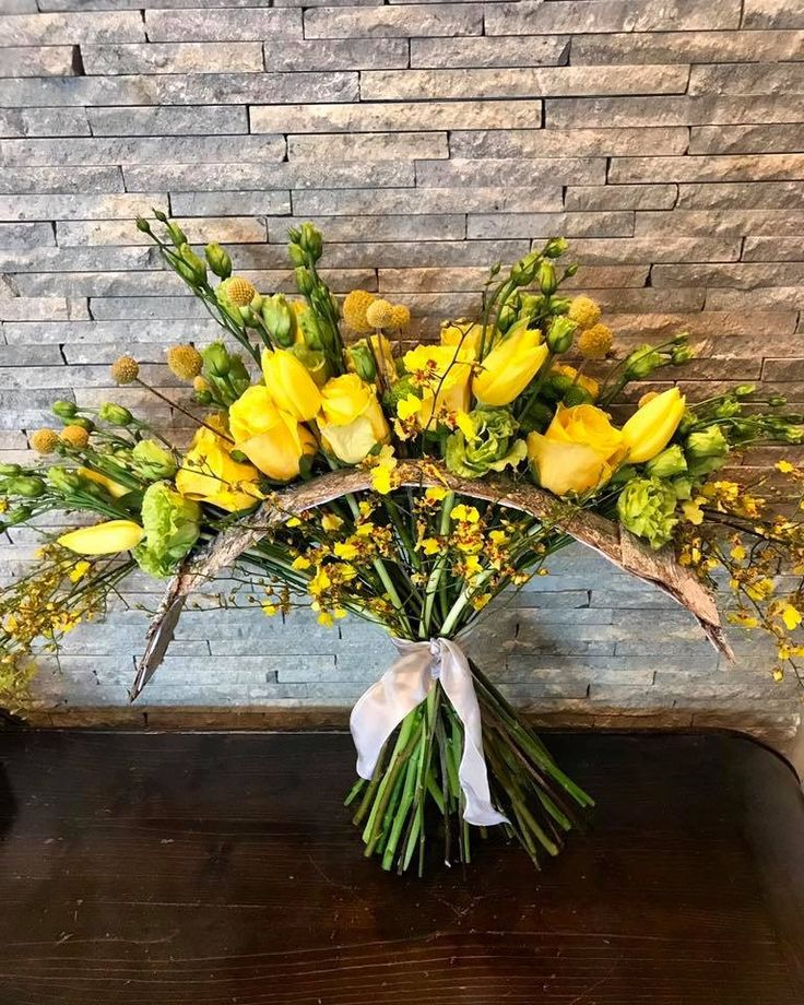 Yellow and green flowers wood structure bouquet by Atelier Floristic Aleksandra