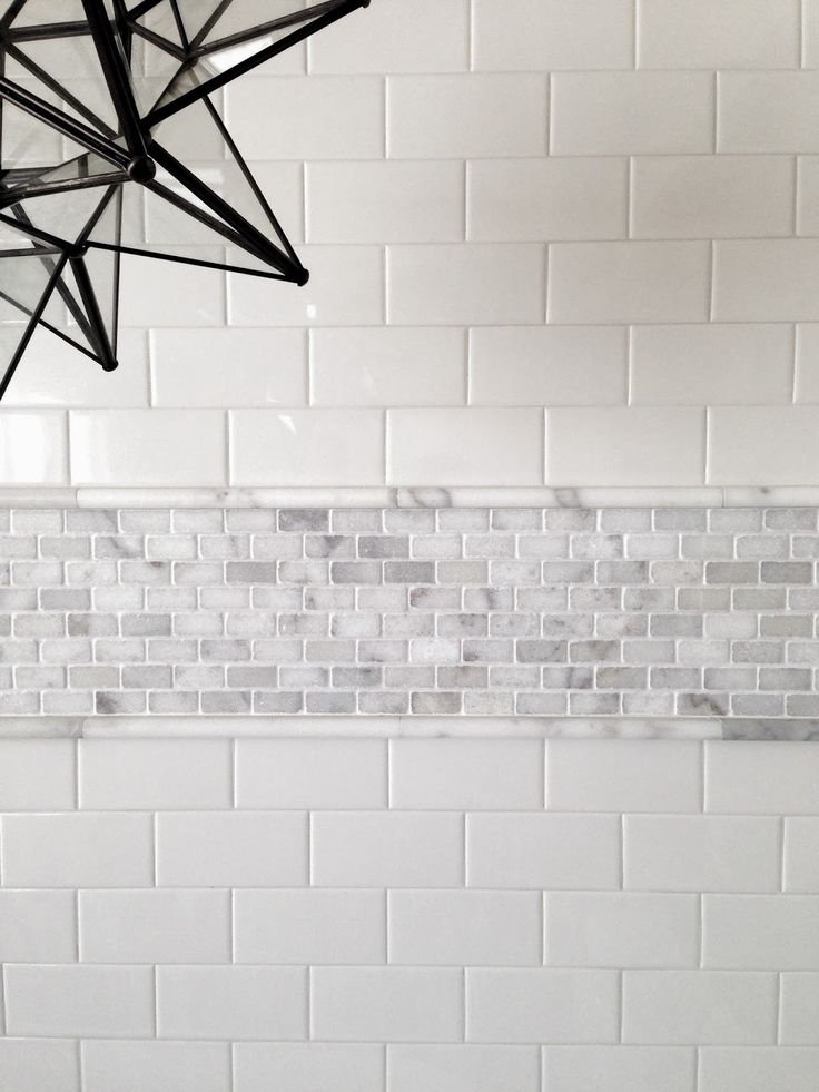 this is carrara with ceramic subway tile the pencil helps deal with the possible thickness differences kids bath idea but maybe swap with a herringbone