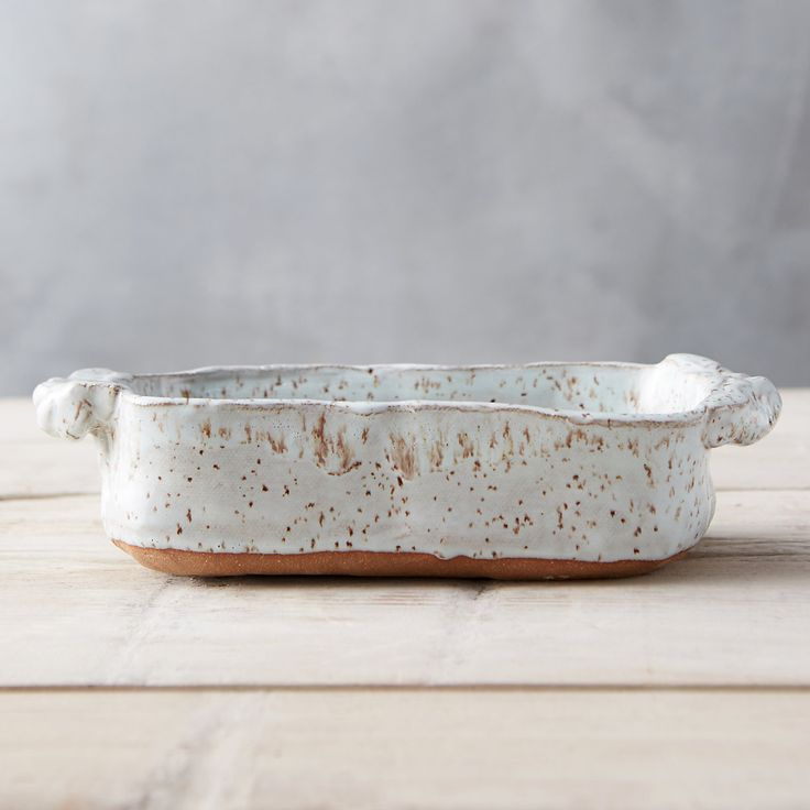Hand-built for truly one-of-a-kind appeal, this rustic loaf pan from Facture Goods is a beautiful gift for the baker.- Glazed earthenware- Hand wash r