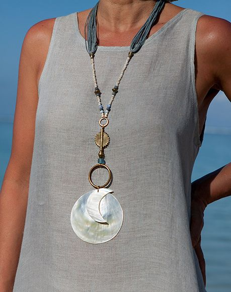 Mother of pearl pendant Sun and Moon. Soli-Lunar necklace : brass African Baule sun bead, small Javanese glass beads, blue waxed cotton threads , thin hand cut mother of pearl moon pendants (diam. 8cm)