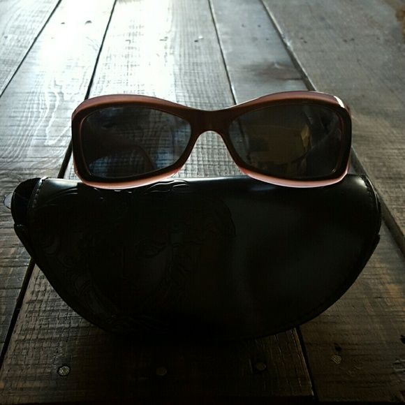 Authentic Versace Sunglasses polarized Purple polarized versace sunglasses with case. Purchased at lens craters and had polarized lenses put in. Missing a few stones on side Versace Accessories Sunglasses