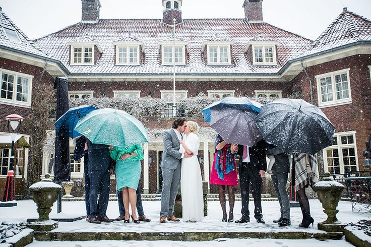 Umbrellas during this winter wedding protected the guests from getting wet, snow, wedding