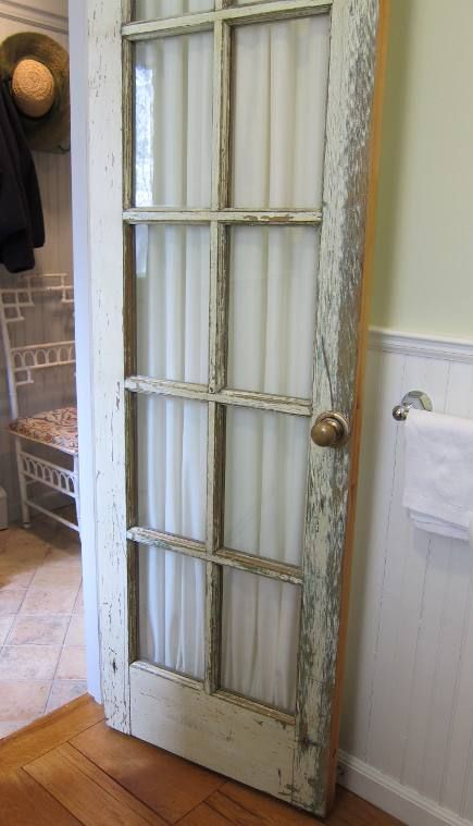 french door to bathroom with lovely diy curtain . . . This would look great with the rustic feel of the house. It would look especially good in the master bedroom with the barn door headboard. I want this!!!