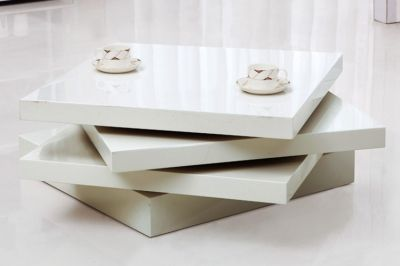 5 Stunning White Gloss Coffee Tables:  http://blog.fads.co.uk/occasional/5-stunning-white-gloss-coffee-tables/