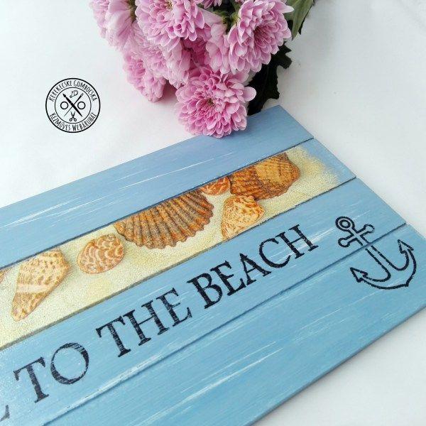 """""""Take me to the beach"""" falidísz - 3990 Ft  Tengerparti hangulatú, felakasztható tábla kék színben, kagylós dekorációval. A tábla mérete: 34×15 cm"""