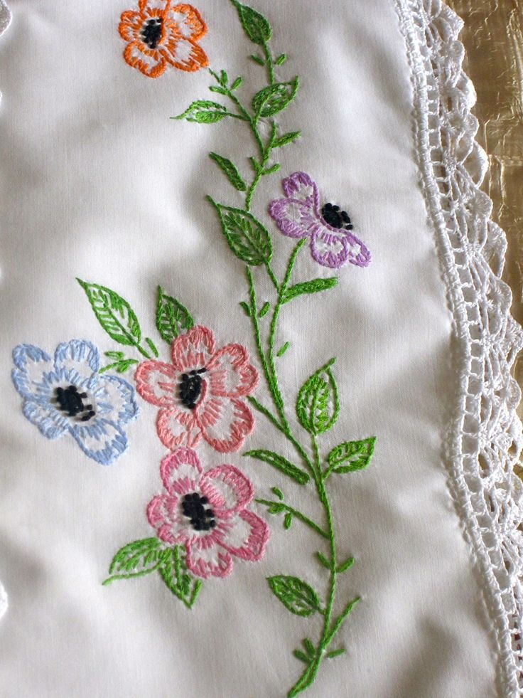 S beautifully white with hand embroidered flowers and