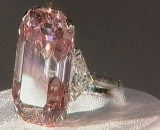 If you want to talk about an expensive ring, look no further than this 10.8 million dollar beauty. It's the world largest diamond which was sold at Christie in Hong Kong. It's five carats of pink diamonds surrounded by white diamonds.