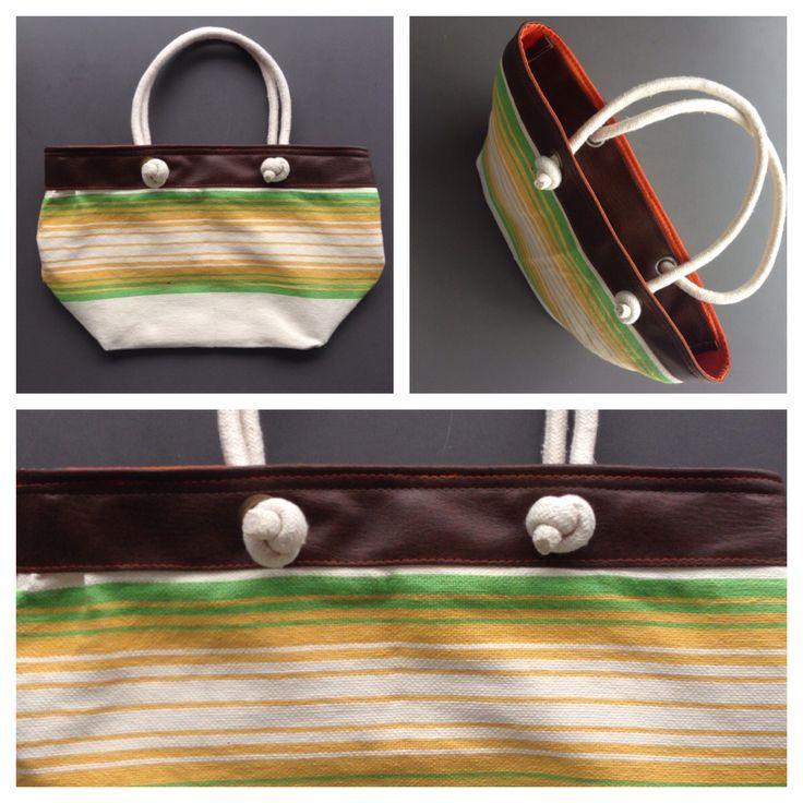 Descripción: Bolso cartera. Color: naranja, café, verde amarillo  Medida: 27x42cm