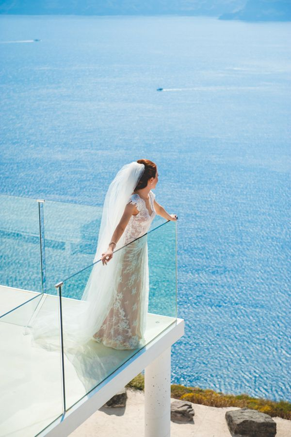 Stunning wedding dress by @CeliaKrithariot Summer destination wedding in Santorini | Maria & Konstantinos - Love4Wed  #CeliaKritharioti #weddingingreece #santorini