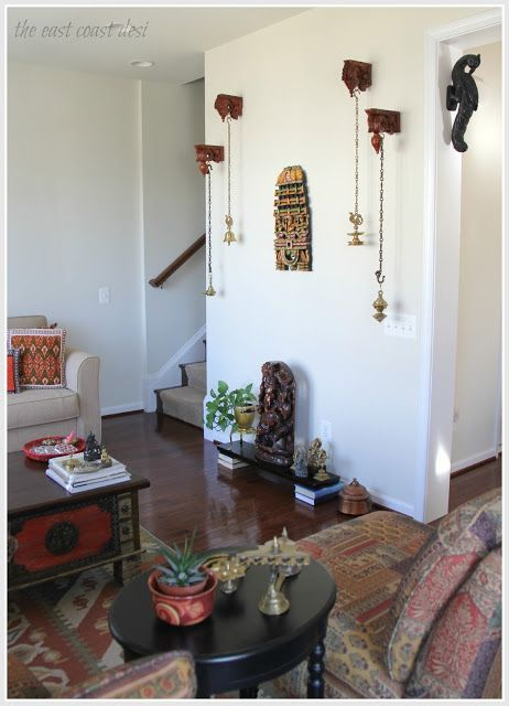 Hanging brass lamps from wooden brackets