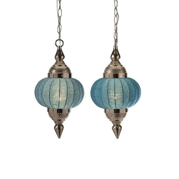 With a hue like the morning sky, these Moroccan-inspired hanging pendant lights brighten up the room. Just plug one in, and light shines through the gorgeous beaded shade, glinting off of the pewter-toned metal finish.