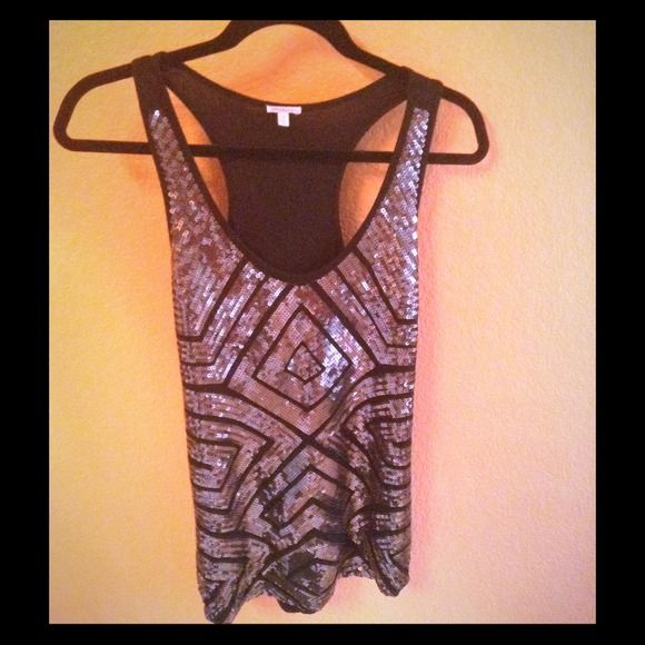 Beautiful sparkly top Beautiful sparkly top. You can pair w dressy pants or Jeans. Looks great for any occasion Tops