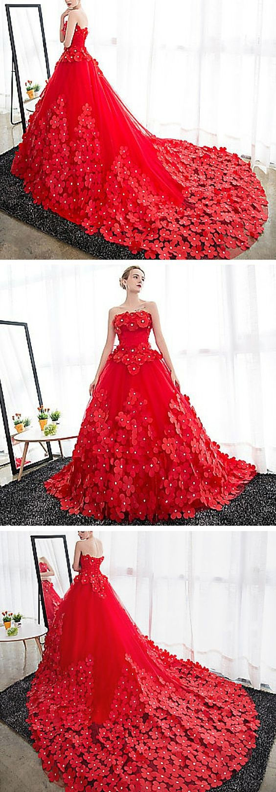 Strapless floral embellished ruby tulle wedding dress. This dramatic gown is surprisingly affordable! It's an amazing choice for the bride who doesn't want to go for a typical white wedding dress. Hello, color! That red is bold and chic. The cathedral train really completes the look.