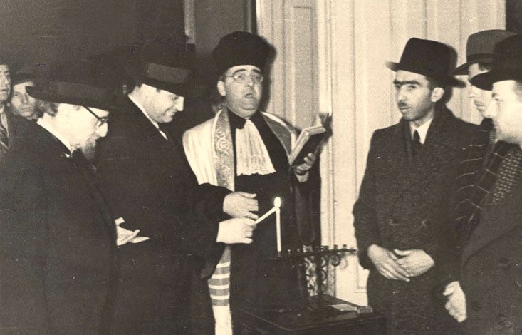 Bucharest, Romania, 1942, Lighting of the Hanukkah candelabrum. Dr. Beck, Hapheral and Ruwuski are present in the photograph
